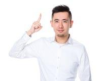 Homem de negócios com ponto do dedo acima Imagens de Stock