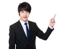 Homem de negócios com ponto do dedo acima Foto de Stock Royalty Free