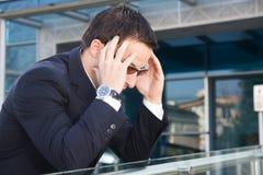 Homem de negócios com problemas Imagens de Stock Royalty Free