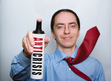 Homem de negócios com pulverizador anticrisis. Imagem de Stock Royalty Free
