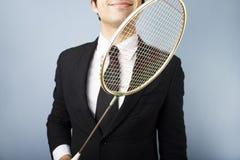 Homem de negócios com raquete de badminton Foto de Stock Royalty Free