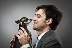 Homem de negócios com seu animal de estimação Foto de Stock Royalty Free