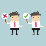 Homem de negócios com sinais direitos e errados Imagem de Stock Royalty Free