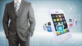 Homem de negócios com smartphones e apps coloridos Imagens de Stock