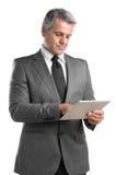 Homem de negócios com tabuleta foto de stock