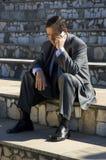 Homem de negócios com telefone Fotos de Stock Royalty Free