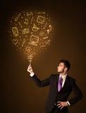 Homem de negócios com um balão social dos meios Imagem de Stock