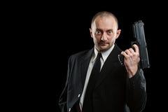 Homem de negócios com um injetor Imagem de Stock