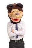 Homem de negócios com um laço que veste uma máscara do urso Fotografia de Stock