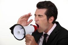 Homem de negócios com um megafone. Fotografia de Stock