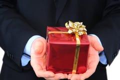 Homem de negócios com um presente Foto de Stock
