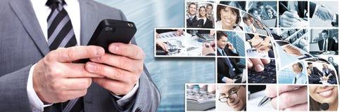 Homem de negócios com um smartphone. Fotografia de Stock Royalty Free