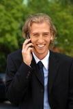 Homem de negócios com um telefone de pilha Imagens de Stock Royalty Free