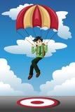 Homem de negócios com uma aterrissagem do paraquedas em um alvo Fotografia de Stock