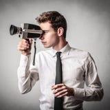 Homem de negócios com uma câmera Imagens de Stock Royalty Free