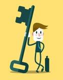 Homem de negócios com uma chave do sucesso Imagem de Stock Royalty Free