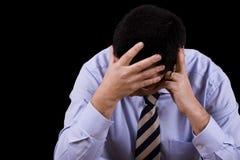 Homem de negócios com uma depressão Imagem de Stock Royalty Free