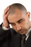 Homem de negócios com uma dor de cabeça Imagens de Stock