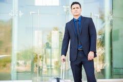 Homem de negócios com uma mala de viagem Imagem de Stock