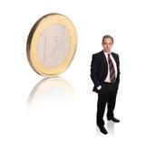 Homem de negócios com uma moeda fotografia de stock