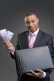 Homem de negócios com uma pasta imagens de stock