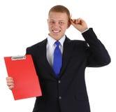 Homem de negócios com uma prancheta Foto de Stock Royalty Free