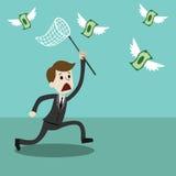 Homem de negócios com uma tentativa líquida da borboleta travar o dinheiro Fotografia de Stock