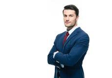 Homem de negócios considerável com os braços dobrados imagens de stock