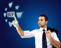 Homem de negócios considerável que aponta ao ícone da compra Imagem de Stock Royalty Free
