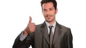 Homem de negócios considerável que gesticula os polegares acima video estoque