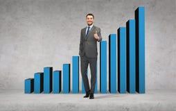 Homem de negócios considerável que mostra os polegares acima Fotos de Stock