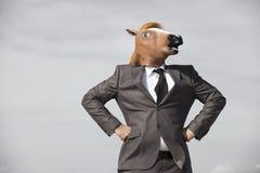 Homem de negócios da cabeça de cavalo fotografia de stock