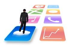 Homem de negócios da vista traseira que surfa no backgroun brilhante do branco dos ícones do app Fotografia de Stock