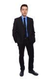 Homem de negócios de encontro a um fundo branco Fotografia de Stock Royalty Free