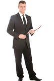 Homem de negócios de sorriso amigável com uma prancheta Imagem de Stock Royalty Free