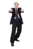 Homem de negócios de sorriso com apontar das mãos fotos de stock royalty free