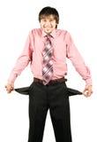 Homem de negócios de sorriso com bolsos vazios Fotos de Stock Royalty Free
