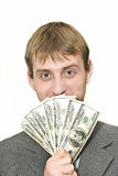 Homem de negócios de sorriso com centenas de dólares Imagens de Stock