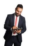 Homem de negócios de sorriso com dobrador Fotografia de Stock Royalty Free