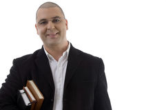 Homem de negócios de sorriso com livros Fotos de Stock