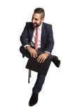 Homem de negócios de sorriso com prancheta Fotos de Stock