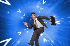 Homem de negócios de sorriso em um hury Fotografia de Stock Royalty Free