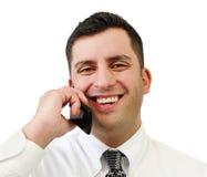 Homem de negócios de sorriso no telefone de pilha fotos de stock