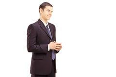 Homem de negócios de sorriso novo disparado durante uma conversação fotos de stock royalty free