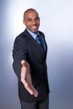 Homem de negócios de sorriso que dá a mão Imagens de Stock Royalty Free