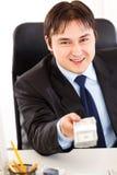 Homem de negócios de sorriso que dá o bloco do dólar Imagem de Stock