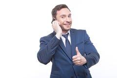 Homem de negócios de sorriso que fala no telefone Imagem de Stock Royalty Free