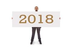 Homem de negócios de sorriso que guarda um cartão vazio realmente grande - 2018 imagem de stock royalty free