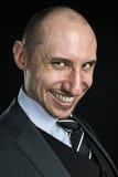 Homem de negócios de sorriso que olha na câmera Imagem de Stock Royalty Free
