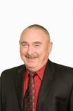 Homem de negócios de sorriso sobre o branco Foto de Stock